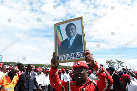 Movement for Democtratic Change supporters pay their last respects to the party's leader Morgan Tsvangirai, in Harare, Monday, Feb, 19, 2018. Zimbabwes veteran opposition leader Morgan Tsvangirai died on Feb 14 aged 65, bringing an end to his long campaign to lead the country. Interim party President Nelson Chamisa said the party would win the elections scheduled for later this year as a tribute to the deceased leader
