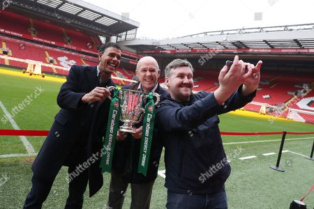 Stock Photo of The Carabao Cup Trophy Relay at Anfield with Chris Kamara, former player Phil Neal and Darren Farley