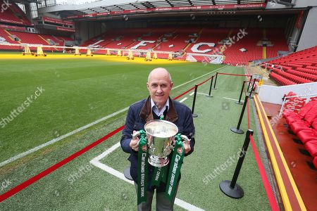 Stock Image of The Carabao Cup Trophy Relay at Anfield with  former player Phil Neal