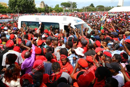 Movement For Democratic Change (MDC T) supporters surround the hearse carrying the casket of Morgan Tsvangirai, at the Freedom Square in Harare, Zimbabwe, 19 February 2018. Hundreds bid farewell to the party leader who died in South Africa on 14 February 2018 from colon cancer. The former Prime Minister will be buried in his rural home in Buhera, 270km east of Harare on 20 February 2018.