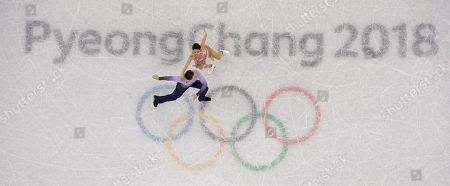 Kana Muramoto and Chris Reed of Japan perform during the ice dance, free dance figure skating final in the Gangneung Ice Arena at the 2018 Winter Olympics in Gangneung, South Korea