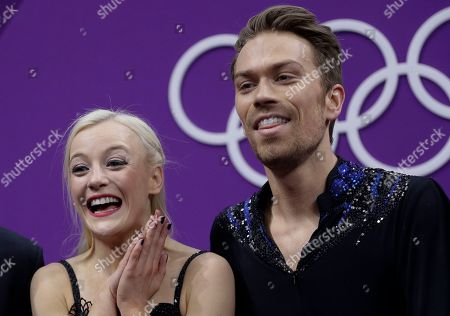 Penny Coomes and Nicholas Buckland of Britain react as their scores are posted following their performance in the ice dance, free dance figure skating final in the Gangneung Ice Arena at the 2018 Winter Olympics in Gangneung, South Korea