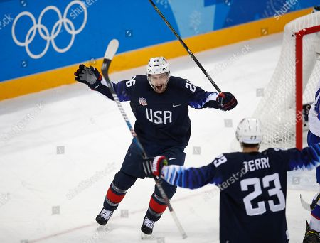 Mark Arcobello (26), of the United States, celebrates with Troy Terry after scoring a goal during the second period of the qualification round of the men's hockey game at the 2018 Winter Olympics in Gangneung, South Korea
