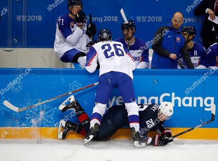 Juraj Mikus (26), of Slovakia, checks Troy Terry (23), of the United States, during the second period of the qualification round of the men's hockey game at the 2018 Winter Olympics in Gangneung, South Korea