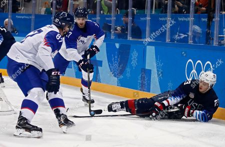 Marcel Hascak (L) and Milos Bubela (C) of Slovakia go for the puck against Troy Terry (R) of United States during the Men's Qualifications match inside the Gangneung Hockey Centre at the PyeongChang Winter Olympic Games 2018, in Gangneung, South Korea, 20 February 2018. The PyeongChang 2018 Winter Olympic Games, will run from 09 to 25 February 2018.