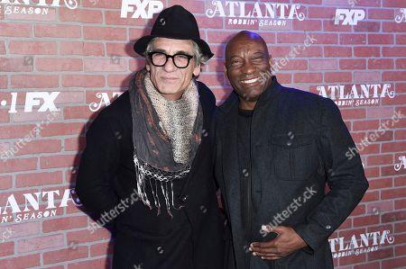 "Alon Abutbul, John Singleton. Alon Abutbul, left, and and John Singleton attend the LA Premiere of ""Atlanta"" Robbin' Season at the Ace Hotel on Monday, Feb.19, 2018, in Los Angeles"