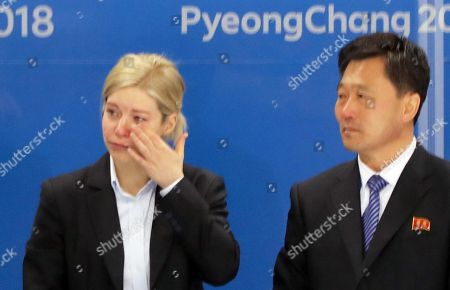 Sarah Murray, head coach of the unified inter-Korean women's ice hockey team, sheds tears next to North Korean coach Pak Chul-ho after their players were defeated in the women's Ice Hockey Classifications match between Sweden and Korea at the Kwandong Hockey Centre during the PyeongChang Winter Olympic Games 2018, in Gangneung, South Korea, 20 February 2018.