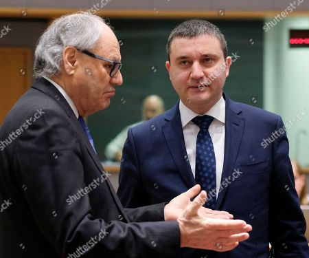 Maltese Finance Minister Edward Scicluna (L) and Bulgaria'Â?s Finance Minister Vladislav Goranov during European Finance Ministers' meeting at the EU Council, in Brussels, Belgium, 20 February 2018.