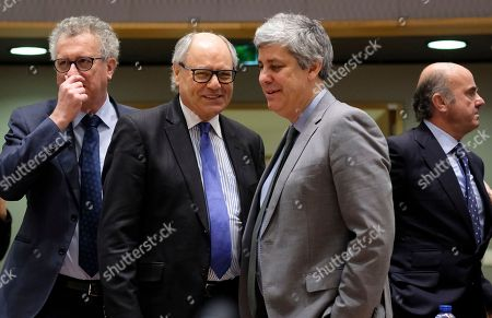 (L-R) Luxembourg's Finance Minister Pierre Gramegna Malta Finance Minister Edward Scicluna, President of the Eurogroup ,  Portuguese Finance Minister Mario Centeno , Spanish Minister of Economy Luis de Guindos during European Finance Ministers' meeting at the EU Council, in Brussels, Belgium, 20 February 2018.