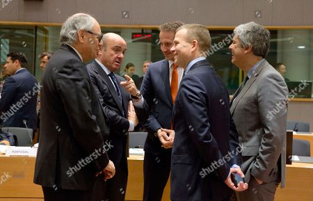 Spanish Economy Minister Luis de Guindos, second left, speaks with from right, Eurogroup President Mario Centeno, Estonian Finance Minister Sven Sester and Danish Finance Minister Kristian Jensen and Malta's Finance Minister Edward Scicluna during a meeting of EU finance ministers at the Europa building in Brussels on . Finance ministers from the 19-country eurozone on Monday endorsed Spain's Luis de Guindos for the coveted post of European Central Bank vice president, after Ireland withdrew the only other candidate