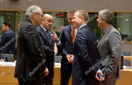 Spanish Economy Minister Luis de Guindos, second left, speaks with from right, Eurogroup President Mario Centeno, Estonian Finance Minister Toomas Toniste, Danish Finance Minister Kristian Jensen and Malta's Finance Minister Edward Scicluna during a meeting of EU finance ministers at the Europa building in Brussels on . Finance ministers from the 19-country eurozone on Monday endorsed Spain's Luis de Guindos for the coveted post of European Central Bank vice president, after Ireland withdrew the only other candidate