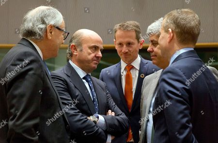 Spanish Economy Minister Luis de Guindos, second left, speaks with from right, Estonian Finance Minister Toomas Toniste, Eurogroup President Mario Centeno, Danish Finance Minister Kristian Jensen and Malta's Finance Minister Edward Scicluna during a meeting of EU finance ministers at the Europa building in Brussels on . Finance ministers from the 19-country eurozone on Monday endorsed Spain's Luis de Guindos for the coveted post of European Central Bank vice president, after Ireland withdrew the only other candidate