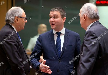 Bulgarian Finance Minister Vladislav Goranov, center, speaks with Malta?s Finance Minister Edward Scicluna during a meeting of EU finance ministers at the Europa building in Brussels on . Finance ministers from the 19-country eurozone on Monday endorsed Spain's Luis de Guindos for the coveted post of European Central Bank vice president, after Ireland withdrew the only other candidate