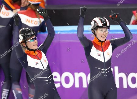 Bronze medalists Yara van Kerkhof (L) and Lara van Ruijven (R) of the Netherlands react after the Women's Short Track Speed Skating 3000 m Relay competition at the Gangneung Ice Arena during the PyeongChang 2018 Olympic Games, South Korea, 20 February 2018.