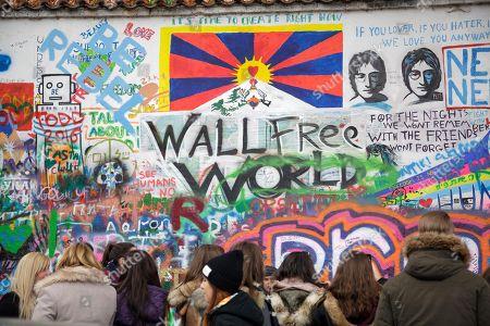 People visiting John Lennon Wall, Prague, Czech Republic