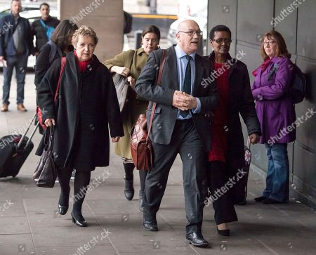 Stock Image of Chair of Oxfam trustees Caroline Thomson, Oxfam CEO, Mark Goldring and Oxfam International executive director Winnie Byanyima arrive at Portcullis House in London where Oxfam bosses are due to give evidence to an International Development Select Committee.