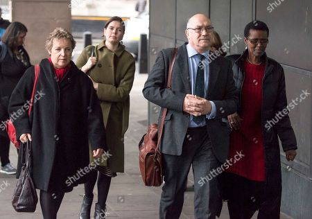 Stock Picture of Chair of Oxfam trustees Caroline Thomson, Oxfam CEO, Mark Goldring and Oxfam International executive director Winnie Byanyima arrive at Portcullis House in London where Oxfam bosses are due to give evidence to an International Development Select Committee.