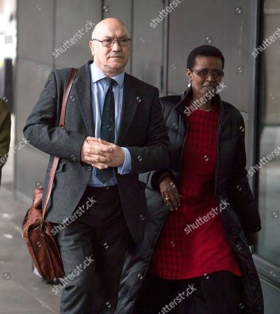 Oxfam CEO, Mark Goldring and Oxfam International executive director Winnie Byanyima arrive at Portcullis House in London where Oxfam bosses are due to give evidence to an International Development Select Committee.
