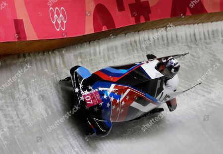 Driver Jamie Greubel Poser and Aja Evans of the United States take a curve in their first heat during the women's two-man bobsled competition at the 2018 Winter Olympics in Pyeongchang, South Korea