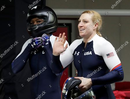 Driver Jamie Greubel Poser, right, and Aja Evans of the United States finish their second heat during the women's two-man bobsled competition at the 2018 Winter Olympics in Pyeongchang, South Korea