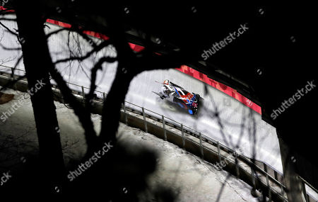 Driver Jamie Greubel Poser and Aja Evans of the United States take a curve in their second heat during the women's two-man bobsled competition at the 2018 Winter Olympics in Pyeongchang, South Korea