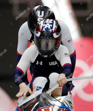Driver Jamie Greubel Poser and Aja Evans of the United States start their first heat during the women's two-man bobsled competition at the 2018 Winter Olympics in Pyeongchang, South Korea