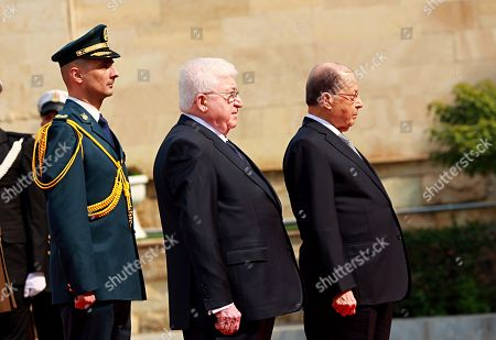 Fuad Masum, Michel Aoun. Iraqi President Fuad Masum, center, and Lebanese President Michel Aoun, right, listen to the national anthems during a welcoming ceremony at Salam Palace in Baghdad, Iraq