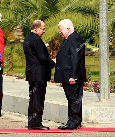 Fuad Masum, Michel Aoun. Iraqi President Fuad Masum, right, shakes hands with Lebanese President Michel Aoun, during a welcoming ceremony at Salam Palace in Baghdad, Iraq