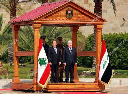 Stock Image of Fuad Masum, Michel Aoun. Iraqi President Fuad Masum, right, and Lebanese President Michel Aoun, listen to the national anthems during a welcoming ceremony at Salam Palace in Baghdad, Iraq