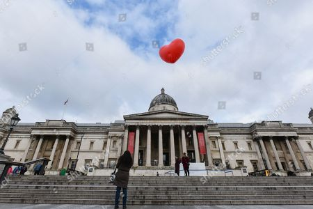 """A Chubby Heart by Anya Hindmarch in Trafalgar Square this morning. """"Starting on Valentine's Day and continuing throughout London Fashion Week, giant chubby heart balloons will be suspended over (and sometimes squashed within) London landmarks as a declaration of love to the city."""""""