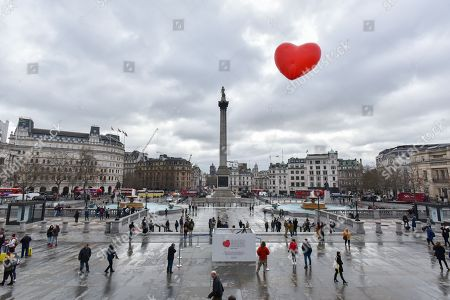 "A Chubby Heart by Anya Hindmarch in Trafalgar Square this morning. ""Starting on Valentine's Day and continuing throughout London Fashion Week, giant chubby heart balloons will be suspended over (and sometimes squashed within) London landmarks as a declaration of love to the city."""