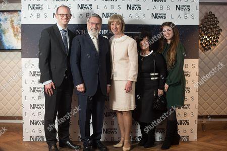 Rabbi Lord Jonathan Sacks and Lady Elaine Sacks with their communications team.