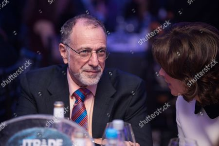Sir Mick Davis with Natasha Kaplinsky.