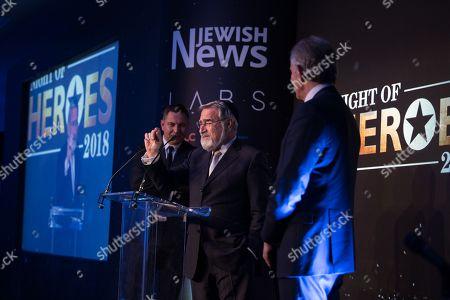 Stock Image of Lord Jonathan Sacks receiving his Lifetime Achievement Award as David Walliams and Tony Blair look on