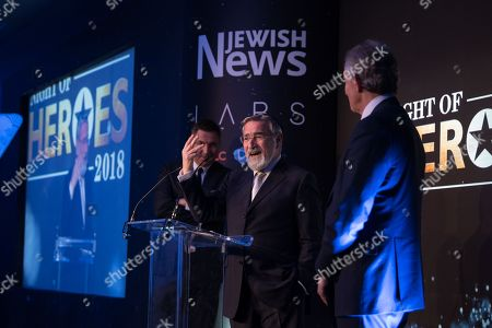 Lord Jonathan Sacks receiving his Lifetime Achievement Award as David Walliams and Tony Blair look on