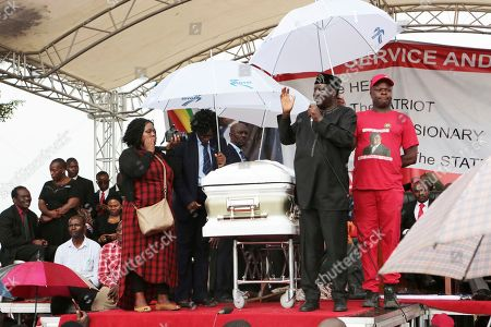 Kenyan Opposition leader Ralia Odinga addresses thousands of people who gathered to pay their last respects to Morgan Tsvangirai in Buhera, Zimbabwe about 200 kilometres south east of Harare, Tuesday, Feb, 20, 2018. Zimbabwe's veteran opposition leader Morgan Tsvangirai, aged 65, died Feb 14 and was laid to rest at his rural home of Buhera