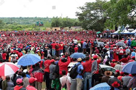 Zimbabwean Movement for Democratic Change supporters gather to pay their last respects during the burial of former leader Morgan Tsvangirai in Buhera, Zimbabwe about 200 kilometres south east of Harare, Tuesday, Feb, 20, 2018. Zimbabwe's veteran opposition leader Morgan Tsvangirai, aged 65, died Feb 14 and was laid to rest at his rural home in Buhera