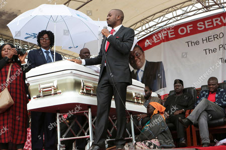 Zimbabwean Movement for Democratic Change interim President, Nelson Chamisa addresses party supporters at the burial of former leader Morgan Tsvangirai in Buhera, Zimbabwe, about 200 kilometres south east of Harare, Tuesday, Feb, 20, 2018. Zimbabwe's veteran opposition leader Morgan Tsvangirai, aged 65, died Feb 14 and was laid to rest at his rural homeof Buhera