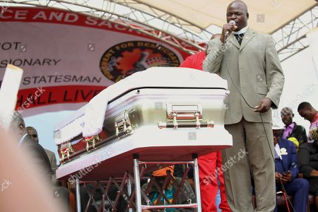 An unidentified cleric speaks next to the coffin prior to the burial of late Morgan Tsvangirai in Humanikwa, Buhera, some 270 kilometers from the capital Harare, Zimbabwe, 20 February 2018. Thousands of people from all over the country attended the mourning event to bid farewell to Zimbabwe's former Prime Minister and MDCT party leader who died in South Africa on 14 February 2018 from colon cancer.