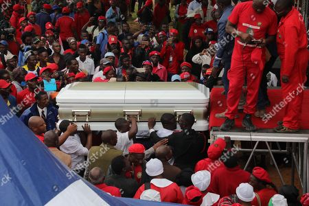 Relatives carry the casket with the body of the late Movement For Democratic Change (MDCT) leader Morgan Tsvangirai in Humanikwa, Buhera, some 270 kilometers from the capital Harare, Zimbabwe, 20 February 2018. Thousands of people from all over the country attended the mourning event to bid farewell to Zimbabwe's former Prime Minister and MDCT party leader who died in South Africa on 14 February 2018 from colon cancer.