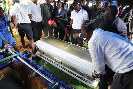 The coffin of late Zimbabwean main opposition leader Morgan Tsvangirai is lowered into its grave in Humanikwa, Buhera, some 270 kilometers from the capital Harare, Zimbabwe, 20 February 2018. Thousands of people from all over the country attended the mourning event to bid farewell to Zimbabwe's former Prime Minister and MDCT party leader who died in South Africa on 14 February 2018 from colon cancer.