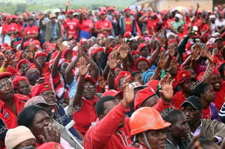 People attend the burial of late Zimbabwean main opposition leader Morgan Tsvangirai in Humanikwa, Buhera, some 270 kilometers from the capital Harare, Zimbabwe, 20 February 2018. Thousands of people from all over the country attended the mourning event to bid farewell to Zimbabwe's former Prime Minister and MDCT party leader who died in South Africa on 14 February 2018 from colon cancer.
