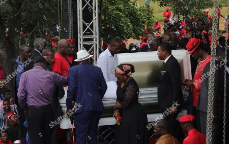 Stock Image of Mourners walk pass the open casket with the body of late Movement For Democratic Change (MDCT) leader Morgan Tsvangirai to bid a final farewell prior to his funeral in Humanikwa, Buhera, some 270 kilometers from the capital Harare, Zimbabwe, 20 February 2018. Thousands of people from all over the country attended the mourning event to bid farewell to Zimbabwe's former Prime Minister and MDCT party leader who died in South Africa on 14 February 2018 from colon cancer.