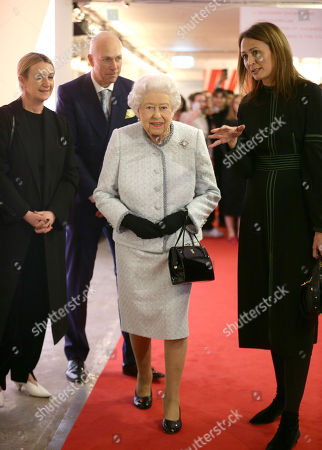 Queen Elizabeth II is given a tour of the London Fashion Week showrooms by Caroline Rush (right), chief executive of the British Fashion Council (BFC), as she visits London Fashion Week's BFC Show Space in central London.