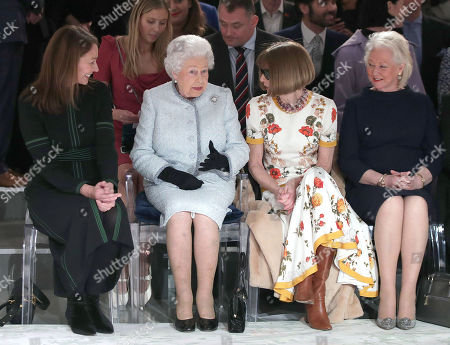 Queen Elizabeth II sits with Anna Wintour (second right) and Caroline Rush (left), chief executive of the British Fashion Council (BFC) and royal dressmaker Angela Kelly (right), as they view Richard Quinn's runway show before presenting him with the inaugural Queen Elizabeth II Award for British Design as she visits London Fashion Week's BFC Show Space in central London.