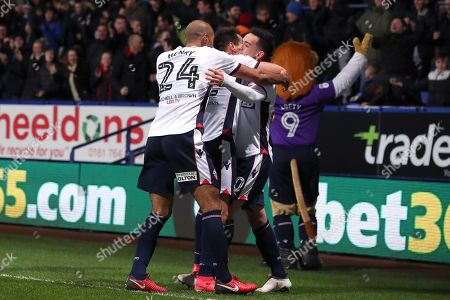 Zac Clough celebrates scoring his sides first goal with Filipe Morais and Karl Henry