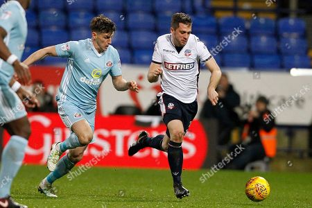 Sunderland defender Billy Jones (2) and Bolton Wanderers defender Andrew Taylor (3) during the EFL Sky Bet Championship match between Bolton Wanderers and Sunderland at the Macron Stadium, Bolton. Picture by Craig Galloway