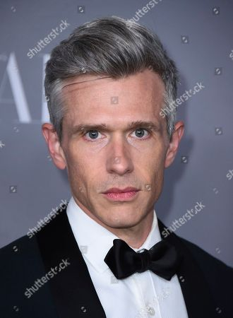 Nate Clark arrives at the 20th annual Costume Designers Guild Awards at The Beverly Hilton hotel, in Beverly Hills, Calif