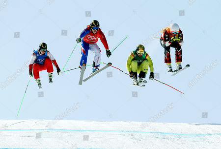 From left; Russian athlete Egor Korotkov, Jean Frederic Chapuis, of France, Paul Eckert, of Germany, and Dave Duncan, of Canada, during the men's ski cross elimination round at Phoenix Snow Park at the 2018 Winter Olympics in Pyeongchang, South Korea