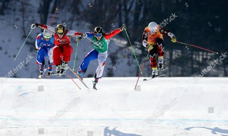 From left; Francois Place, of France, Russian athlete Sergey Ridzik, Jean Frederic Chapuis, of France, and Dave Duncan, of Canada, run the course during the men's ski cross quarterfinal at Phoenix Snow Park at the 2018 Winter Olympics in Pyeongchang, South Korea